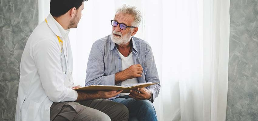 senior-citizen-sitting-next-to-speech-therapist-in-skilled-nursing-facility