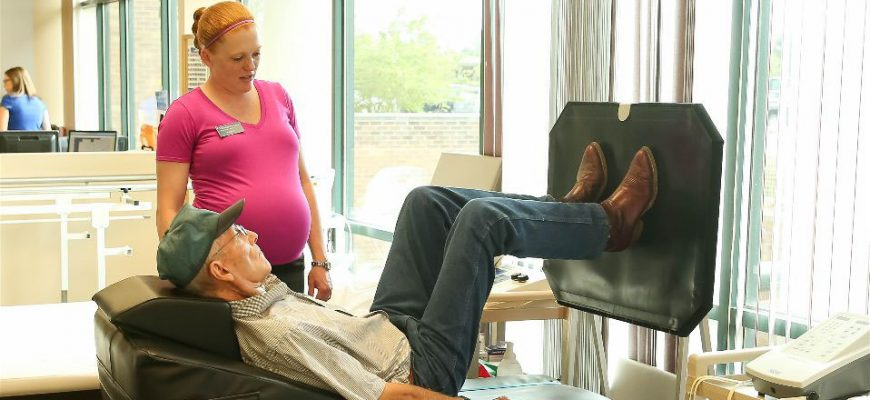A skilled nurse at a Pasadena care center helps a senior engage in physical therapy.