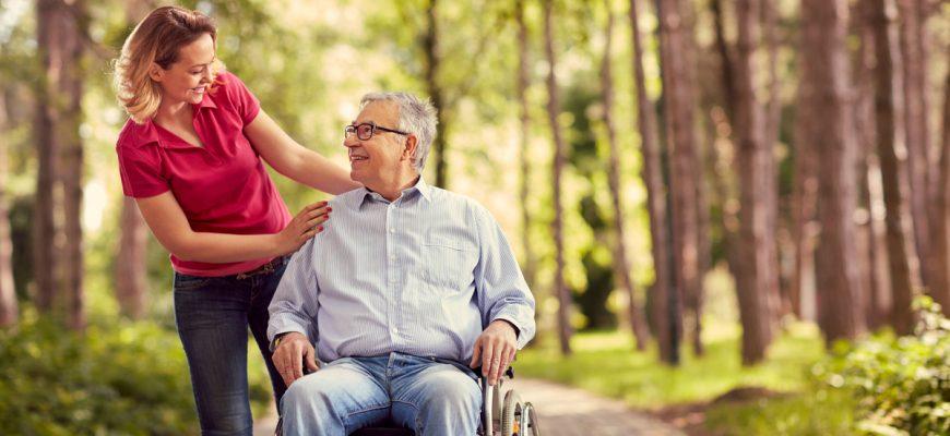 nursing home senior in wheelchair visiting family