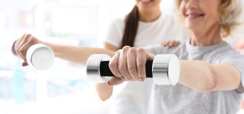 Senior undergoes rehabilitation with weight training in a skilled senior nursing facility.