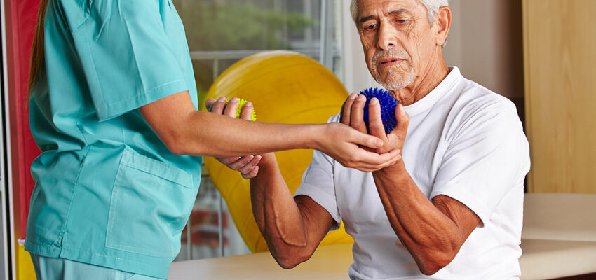 Senior working together with a physiotherapist for short term rehabilitation post surgery.