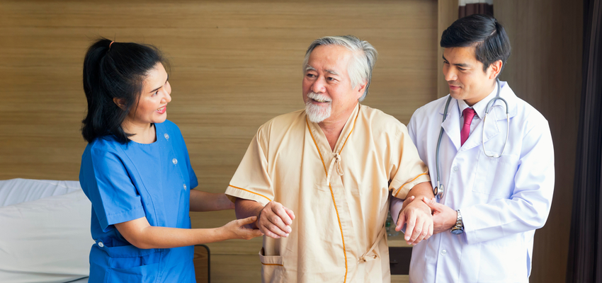 A doctor and nurse assist a man in a Pasadena skilled nursing facility